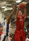 Munster's Pat McCarthy pulls down a rebound from Merrillville's Darion Williams