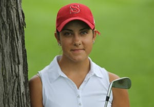 Maggie Sloan begins her third year on the T.F. South boys varsity golf team
