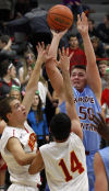Hanover Central's Brandon Sears shoots over Andrean's Chris Wolak, left, and Parker Huttel