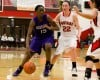 Merrillville sophomore Victoria Gaines, left, drives past Portage senior Nicki Monahan