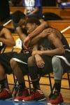 21st Century's Davis Jarnigan comforts teammate Dantrell Hurt