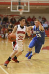 Washington Township's Alex Perez is chased by Boone Grove's Sam Eleftheri during Thursday's opening round of the Porter County Conference tourney.