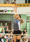 Chesteton's Jessica Urycki goes up for a block against Valparaiso