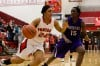 Portage forward Alexis Johnson, left, drives against Merrillville