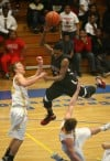 21st Century's Mykel Mayes is fouled by Pioneer's Stephen Whitlock 