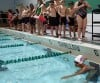 Swimmers prepare to enter the pool at the Valparaiso Junior Triathlon on Saturday.