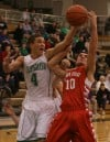 Valparaiso's Tyler Doane and Crown Point's Alex Nickla battle for a rebound