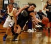 Lake Central's Tara Zlotkowski and Lowell's Kalyne Godbolt, left, go for a loose ball S