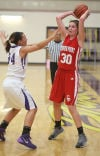 Hobart's Grayce Roach guards Crown Point's Abby Kvachkoff on Friday night.