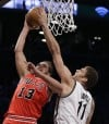 Noah, Johnson hobbled as Bulls, Nets resume series  