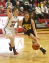 South Central's Olivia Tolmen guards Kouts' Megan Heinold during Saturday's PCC tourney title game.
