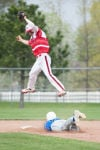 Portage senior shortstop Michael Lattanzi leaps up for the ball as Lake Central senior Alex Mantel arrives safely at second base during Wednesday's game.