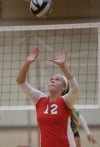 Munster's Morgan Switalla sets a teammate during Thursday's match against Valparaiso.