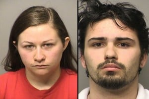 Man, woman charged with molesting infant
