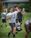 Mount Carmel quarterback Marko Boricich passes Saturday during at the 7 on 7 tournament at Richards.