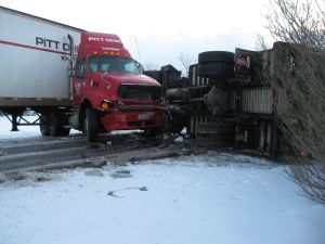 Icy, snow-covered roads cause crashes, slow a.m. commute