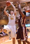 Valparaiso University's Ryan Broekhoff scores over the Robert Morris