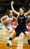Purdue Calumet's Kami Graber is guarded by Oregon Tech's Tess Armstrong during Wednesday's first round of the NAIA Division II Tournament at the Tyson Events Center in Sioux City, Iowa.