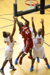 E.C. Central's Charlie Cleveland goes up for a shot between West Side's Justin Mitchell and Ramone Atkins on Wednesday in the Class 4A E.C. Central Sectional.