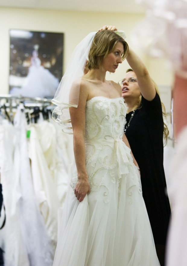 Local bridal boutique gives away free wedding dresses to for Free wedding dresses for military brides