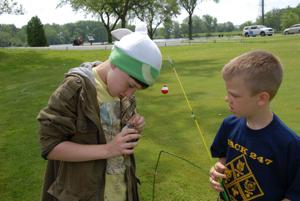 Cub Scouts reel 'em in at fishing derby