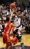 Merrillville's Jalen Wilbert shoots over Andrean's Nick Davidson