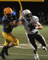 MTC LT 8AMount Carmel wide receiver Jason Gasser fights for extra yards after a first-quarter reception-4.jpg
