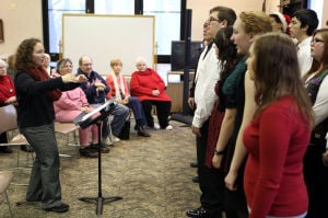 Student musicians entertain during Christmas dinner at Lowell library