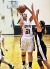 Washington Township's Samantha Higgins shoots a jumper Tuesday night against Covenant Christian at the Class A Kouts Sectional.