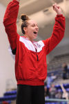 Crown Point's Aly Tetzloff celebrates her 100-yard fly victory during the medal ceremony. She broke the meet mark with a 52.7 Saturday.