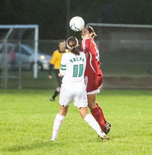 Munster's Jessica Flores heads the ball as Valparaiso's Alexis Ferngren