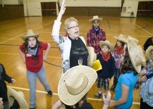 Students, seniors square dance