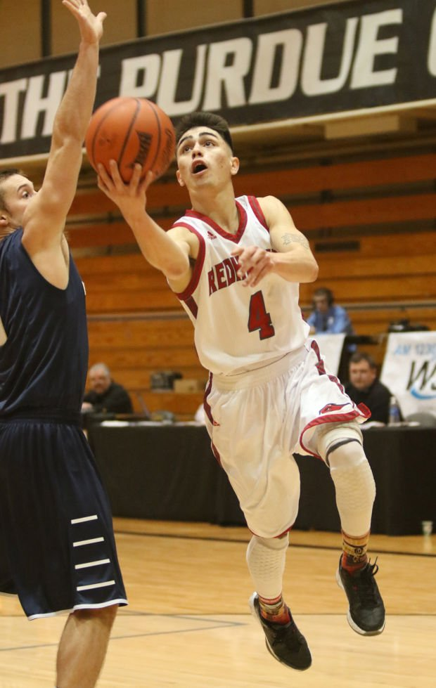 IU Northwest's Nate Flores drives for a layup Friday against Judson