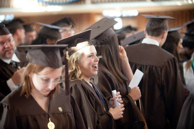 Valparaiso University student Cynthia Cunningham smiles as she stands with fellow education majors before their commencement. © The Times/Kyle Telechan
