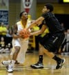 Valparaiso's Erik Buggs, left, and Green Bay's Carrington Love fight for possession