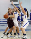 Chesterton's Hailee Norton is double-teamed by Lake Central's Vicki Gard, center, and Ashley O'Malley