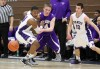 Merrillville's Jalen Wilbert, left and Hobart's Patrick Wynn eye a loose ball during the first half Thursday.