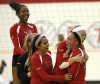 T.F. South volleyball celebrates a point against Marian Catholic