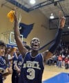 Bishop Noll's Adonis Filer celebrates a 51-41 win