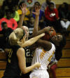 Illiana Christian's Joanne Klapak and Seton Academy's Brittany Hardeman battle for a rebound Thursday night.