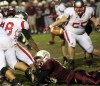 Mishawaka's Braxton Eby forces a fumble by Morton's Kendall Huff