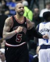 Bulls use amnesty clause to cut Boozer