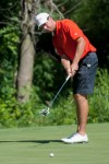 Crown Point alum Nick Grubnich putts on No. 2 of the Marsh Course at Sand Creek on Thursday at the Northern Amateur. Grubnich had a 77.