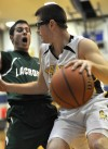 Kouts' Andy Lovall drives around the defense