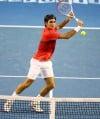 Federer strolls into Australian Open quarterfinals