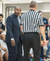 Michigan City coach John Boyd argues with an official