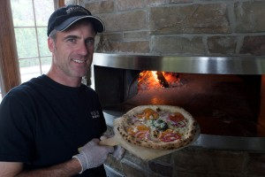Stop 50 Woodfire Pizza's local philosophy