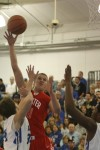 Munster's Nate Bubash puts up a shot against Lake Central