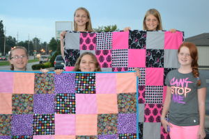 Making quilts for sick children