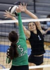 Valparaiso's Morgan Mikenas tries to hit around the block of Lake Central's Victoria Gardenhire on Thursday.